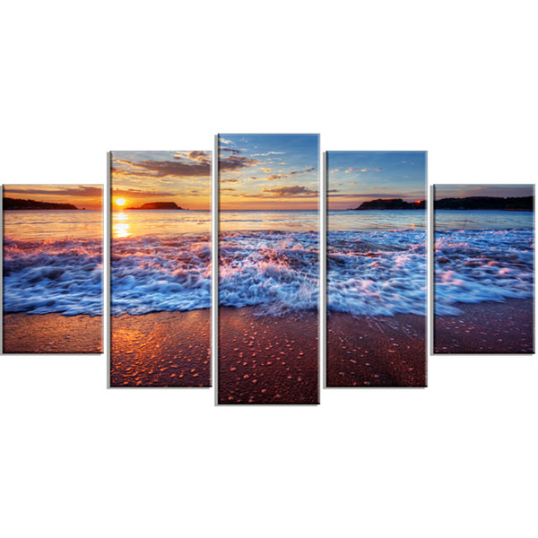 Designart Blue Sea Waves During Sunset Large Seashore Canvas Art Print - 5 Panels