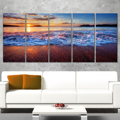 Designart Blue Sea Waves During Sunset Seashore Canvas Art Print - 5 Panels