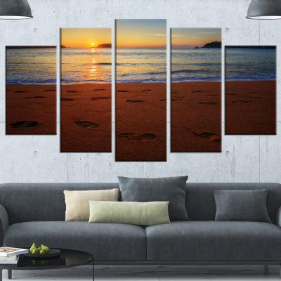 Designart Foot Printed Sandy Ocean Beach SeashoreCanvas Art Print - 5 Panels