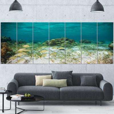 Designart School Of Grunts With Baracuda SeashoreCanvas Art Print - 5 Panels