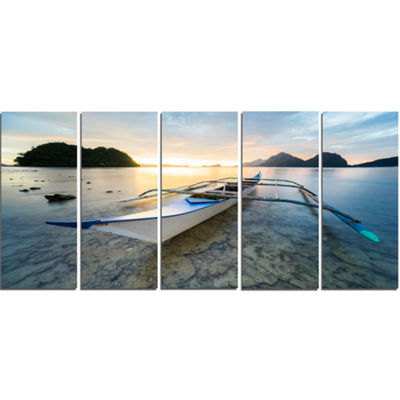 Designart Boat Docked At Beautiful Sunset SeashoreCanvas Art Print - 5 Panels
