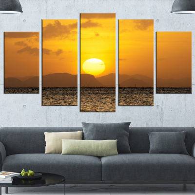 Designart Yellow Sunset And Brown Ocean SeashoreCanvas Art Print - 5 Panels
