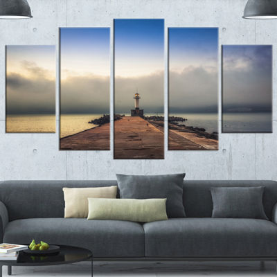 Designart Lighthouse On Coast And Cloudy Sky Modern Canvas Art Print - 5 Panels