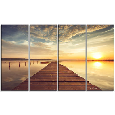 Designart Sea Pier Under Beautiful Cloudscape Modern Canvas Art Print - 4 Panels