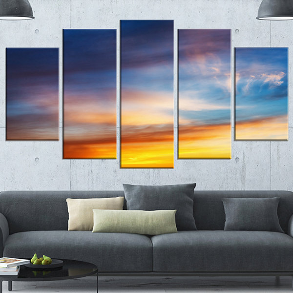 Designart Sunset Dramatic Yellow Sky Clouds LargeSeashore Canvas Art Print - 5 Panels