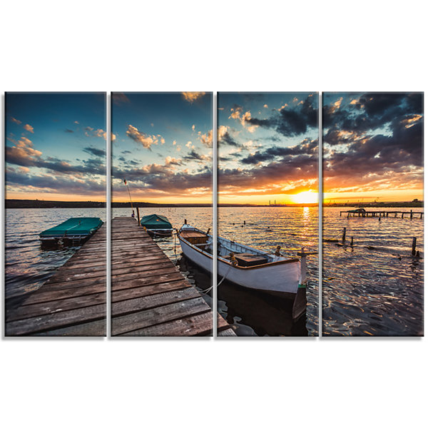 Designart Boats And Jetty Under Dramatic Sky Modern Canvas Art Print - 4 Panels