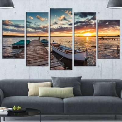Designart Boats And Jetty Under Dramatic Sky LargeModern Canvas Art Print - 5 Panels