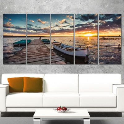Designart Boats And Jetty Under Dramatic Sky Modern Canvas Art Print - 5 Panels