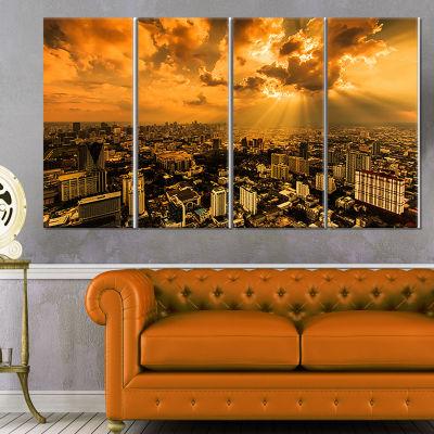 Designart Light Shining Through Dark Clouds ExtraLarge Canvas Art Print - 4 Panels