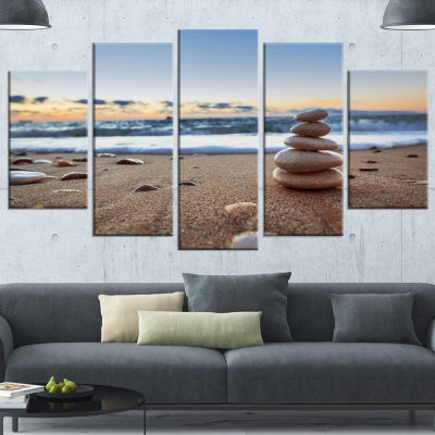 Designart Stones Balance On Sandy Beach SeashoreWrapped Canvas Art Print - 5 Panels