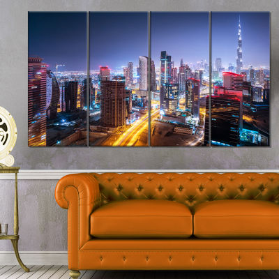 Designart Fantastic Night Cityscape Extra Large Canvas Art Print - 4 Panels
