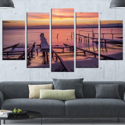 Designart Fishing Pier In Sea At Sunset SeashoreWrapped Canvas Art Print - 5 Panels
