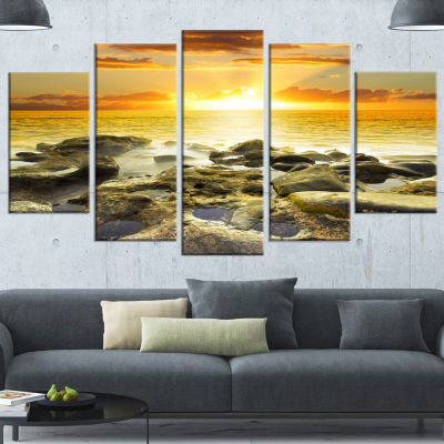 Designart Beautiful Orange Sundown Beach SeashoreWrapped Canvas Art Print - 5 Panels