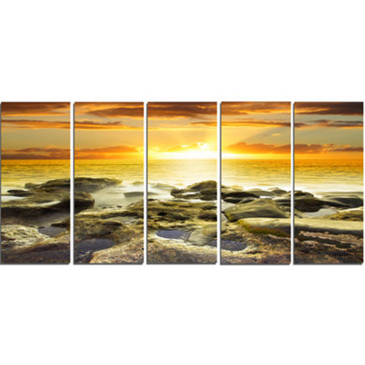 Designart Beautiful Orange Sundown Beach SeashoreCanvas Art Print - 5 Panels