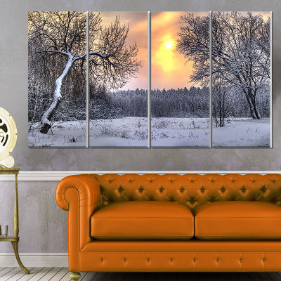 Designart Winter Landscape With Yellow Sun Landscape Canvas Art Print - 4 Panels