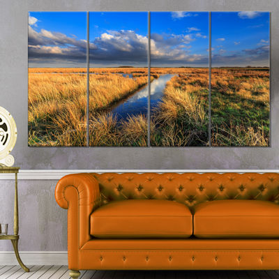 Designart Meadow Land With Beautiful SkyscrapersLandscape Canvas Art Print - 4 Panels