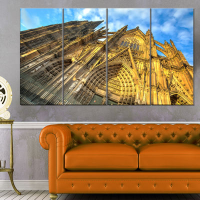 Designart Facade Of Dom Church With Blue Sky LargeCityscapeArt Print On Canvas - 4 Panels