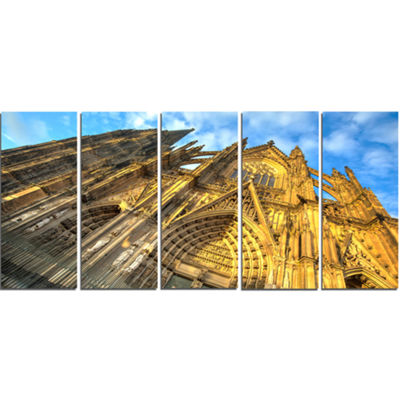 Designart Facade Of Dom Church With Blue Sky LargeCityscapeArt Print On Canvas - 5 Panels