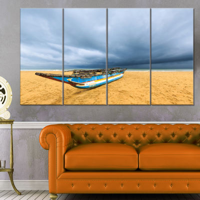 Fishing Boat On Beach With Dark Clouds Large Seashore Canvas Art Print - 4 Panels