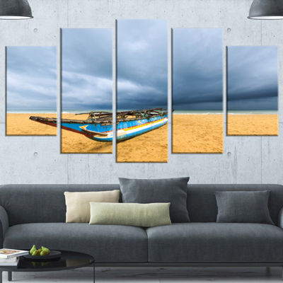 Designart Fishing Boat On Beach With Dark CloudsLarge Seashore Wrapped Canvas Art Print - 5 Panels