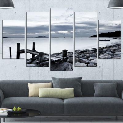 Designart Small Sea Bridge From Rocky Beach Landscape Wrapped Canvas Art Print - 5 Panels
