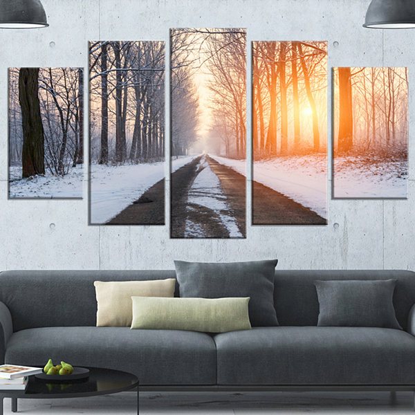 Designart Bright Sun Break In Winter Forest LargeForest Wrapped Canvas Art Print - 5 Panels