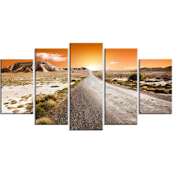 Designart Sunset Desert With Pebble Road LandscapeWrapped Canvas Art Print - 5 Panels