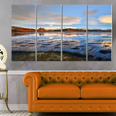 Designart Approach To Dyrholaey Durign Sunrise Large Seashore Canvas Art Print - 4 Panels