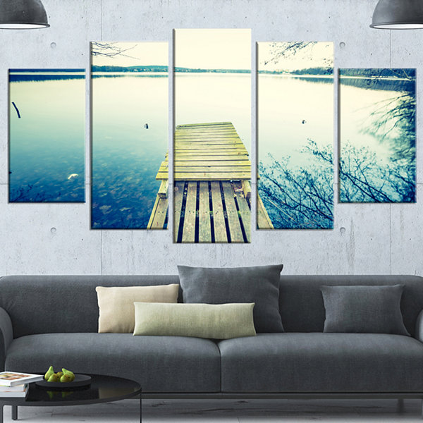 Designart Sunset Over Tranquil Lake Bridge CanvasArt Print- 4 Panels