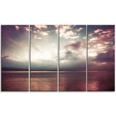 Designart Dark Sunset With Dramatic Sky Large Seashore Canvas Art Print - 4 Panels