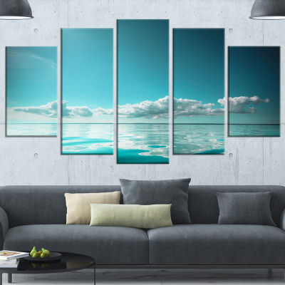 Designart Blue Sea Horizon And Skyscraper Large Seashore Wrapped Canvas Art Print - 5 Panels