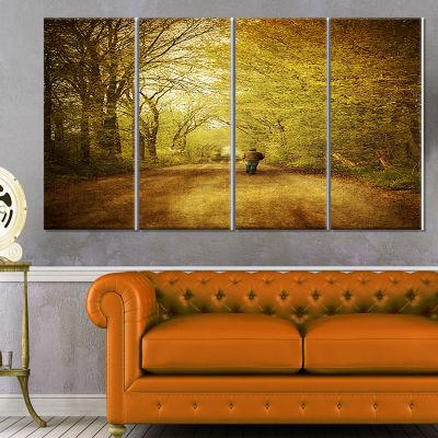 Designart Man Walking Lonely On Rural Road Landscape Canvas Art Print - 4 Panels