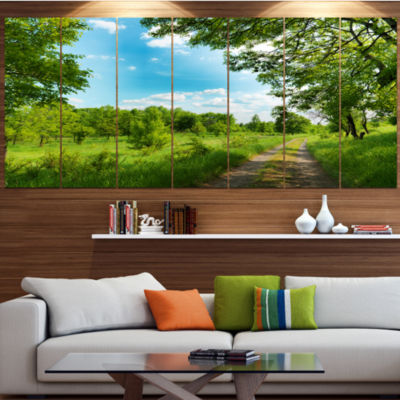 Designart Green Forest Road And Blue Sky Modern Landscape Canvas Art - 4 Panels