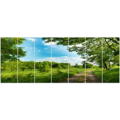 Designart Green Forest Road And Blue Sky Modern Landscape Canvas Art - 7 Panels