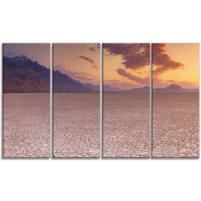 Designart Cracked Earth In Alvord Desert LandscapeCanvas Art Print - 4 Panels