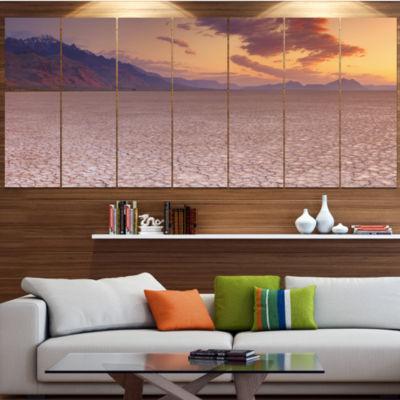 Designart Cracked Earth In Alvord Desert LandscapeCanvas Art Print - 7 Panels