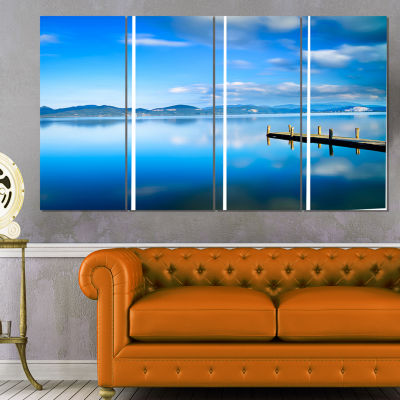 Designart Cloudy Sky Over Blue Sea Seascape CanvasArt Print- 4 Panels