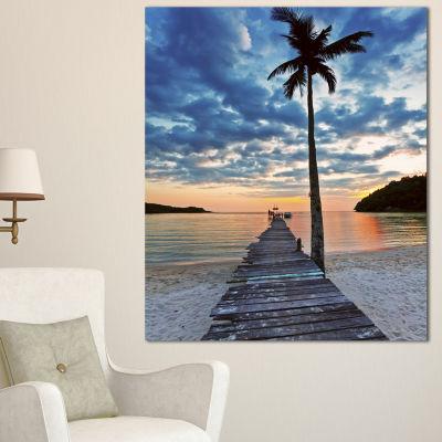 Designart Wooden Pier and Palm Tree Seashore PhotoCanvas Art Print - 4 Panels