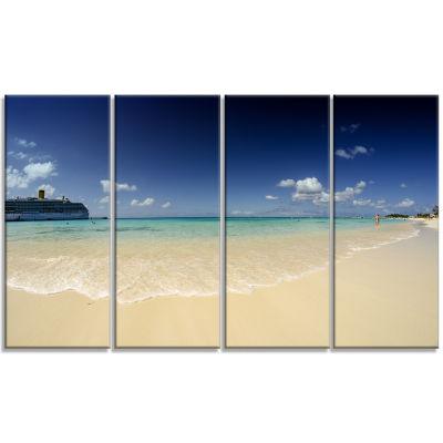 Designart Crystal Waters Of Grand Cayman SeashorePhoto Canvas Print - 4 Panels