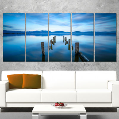 Designart Deep Into The Sea Pier Seascape CanvasArt Print -4 Panels