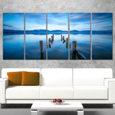 Designart Deep Into The Sea Pier Seascape CanvasArt Print -5 Panels