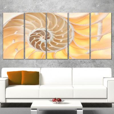 Designart Golden Nautilus Shell Pattern Abstract Canvas ArtPrint - 4 Panels