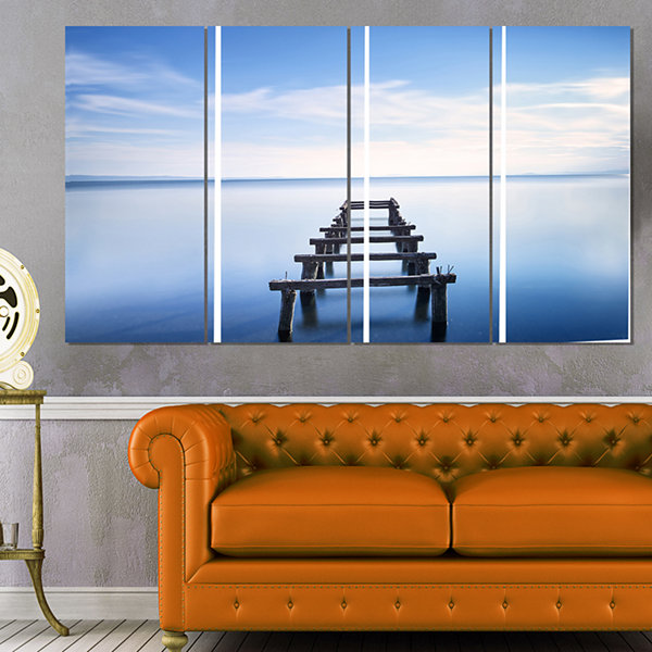 Jetty Remains In Blue Lake Seascape Canvas Art Print - 4 Panels