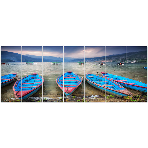 Designart Row Of Blue Boats In Pokhara Lake BoatCanvas Art Print - 7 Panels
