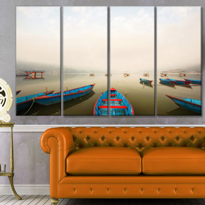 Moving Boats In Mountain Lake Boat Canvas Art Print - 4 Panels