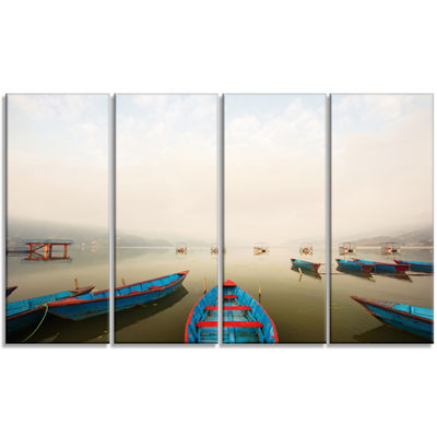 Designart Moving Boats In Mountain Lake Boat Canvas Art Print - 4 Panels