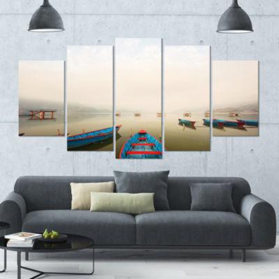 Designart Moving Boats In Mountain Lake Boat LargeCanvas Art Print - 5 Panels