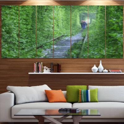 Designart Couple Walking Into Tunnel Landscape Large Canvas Art Print - 5 Panels