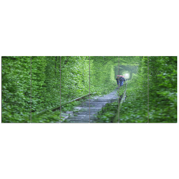 Designart Couple Walking Into Tunnel Landscape Canvas Art Print - 6 Panels