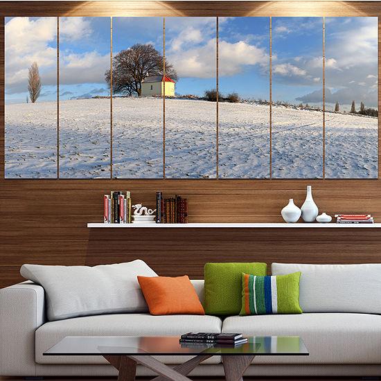 Designart Winter Landscape With Chapel LandscapeCanvas Art Print - 7 Panels